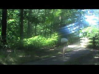 Walking Down A Trail In A Shirt And Diaper