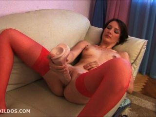 Brunette In Red Stockings Masturbating With A Big Brutal Dildo
