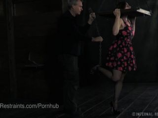 Busty Bella Rossi Suspended By Wooden Bondage Device