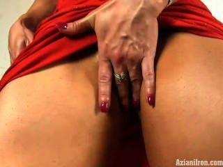 Hard Muscles And A Big Clit In A Sexy Red Dress