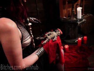 Brutal Redhead Dominatrix Goddess