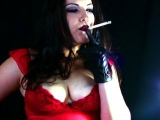Alexxxia Smoking And Talking A Bit Dirty In Leather Gloves