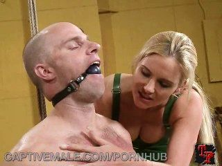 Dominatrix Holds A Delivery Man Captive