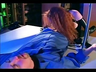Redhead In A Cop Uniform And Latex Gloves And Corset Fucking