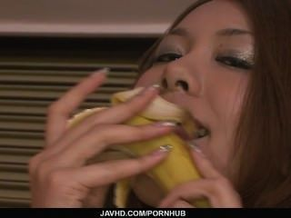 Hot And Sexy Redhead Playing With A Hard Banana In The Kitchen