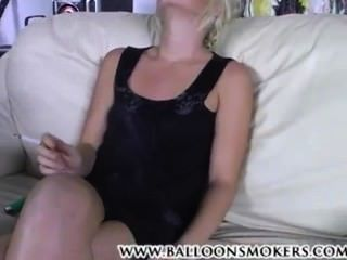 Blonde Smoking Two Cigarettes At Once