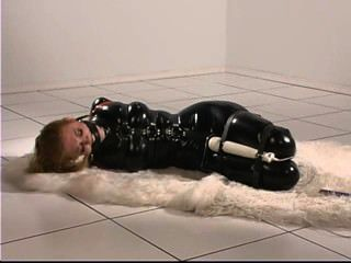 Latex Bound Cutie Struggles For Orgasms