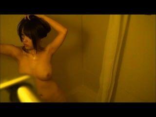 An Asian Girl Is Taking Bath