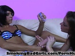 Two Teens Smoking Cigarettes Taking Turns Blowing Dildo