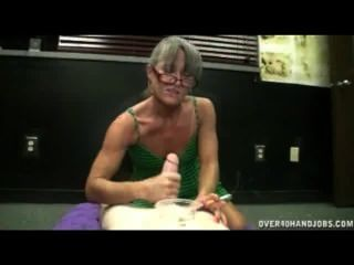 Mature Lady Gives Handjob While Smoking