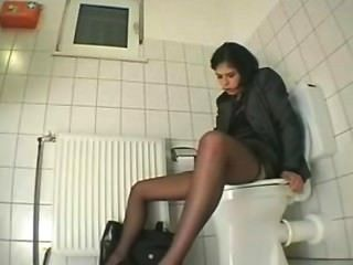 Girl Masturbates In Restroom