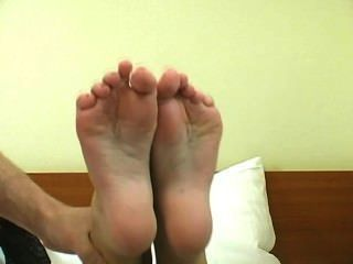 Gorgeous Brunette Gives A Footjob And Gets A Load On Her Soles