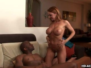 Alluring Brunette Takes In A Large Black Dick