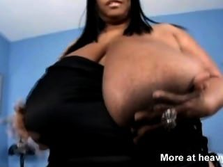 Obese Ebony Girl Playing With Her Tits
