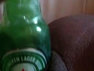 Bouteille De Heineken En Guise De Gode