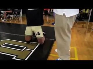 College Wrestler Adjusting Bulge