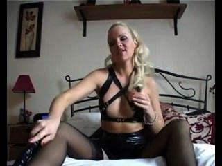 Sexy Blonde Milf Mistress In Pvc Wear And Stockings Teases And Uses Dildo
