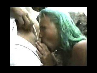 Green Haired Girl Sucks And Takes Facial In Front Of Everyone