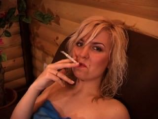 Blonde Girl Smoking Long White Cigarette