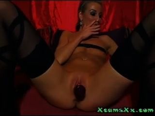 Blond Milf Smoking And Toying With A Dildo On