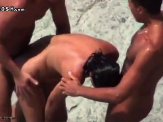 Amateur Threesome On The Beach