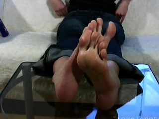 Girl With Big Feet Massages Her Soles