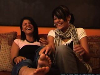 Two Latinas Smelling Each Others Socks And Feet